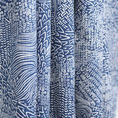 A modern, global fabric with a hand drawn print in an inky blue with white contrast lines. Fabric has a lovely textural slub.Perfect for drapes, roman blinds, d