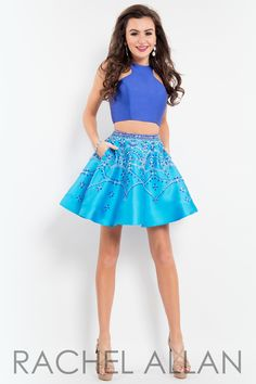 Two-piece A-line with solid mikado top and a matted-jeweled skirt. Available in Black/White, Coral/White, Emerald/White, Royal/Turquoise and Teal/White and it's at Rsvp Prom and Pageant, your source f