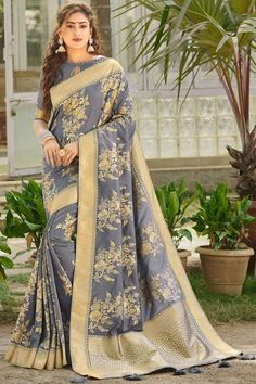 Grey banarasi silk saree with grey silk blouse, mbellished with woven zari. Saree with Key Hole Neck, Half Sleeve. It comes with unstitch blouse, it can be stitched 32 to 58 sizes. #grey #banarasi silk #saree #blouse #indiansaree # #Andaazfashion #USA