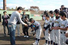 Takashi Saito presents a new baseball glove a Japanese Little Leaguer whose baseball equipment had been destroyed in the 2011 tsunami.