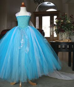 Disney Frozen Snow Queen Elsa Tutu Dress Costume with optional removable train by JustaLittleSassShop, Girls sizes 6-10.  $127.00 We hand glittered the bodice of the dress  and added in tons of glitter tulle, shimmer tulle and snowflake ribbon.  The optional full length train completes the Elsa look with pearlescent flakes.  Pictures don't do this dress justice.