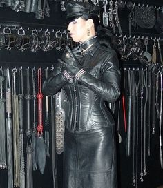 tle78:  Leather Domina. Has one of the best wardrobes in the world.   And,sorry,one of the most expensive.