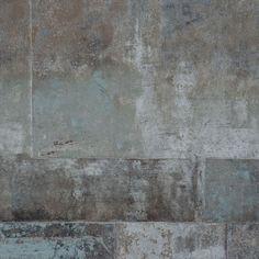 Betongmönster med oregelbundna rutor, i brunt, grått, svart och svagt blå nyans