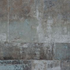 Concrete Patterns of irregular squares of brown, gray, black and pale blue tint
