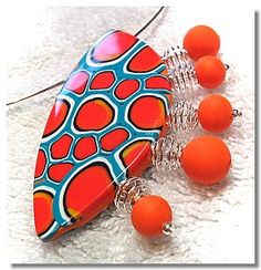Bright and funky pendant by Chris Pellow (link isn't working) - like the focal not so keen on the extras.