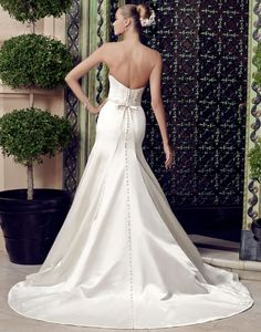 Strapless Duchess Satin Fit N Flare Wedding Gown With Modified Sweetheart Neckline, Removable Beaded Sash At Natural Waist, Satin Covered Buttons That Run The Back Of The Gown, Skirt, & Court Length Train (Back View); by Casablanca Bridals Spring 2015 Collection××××