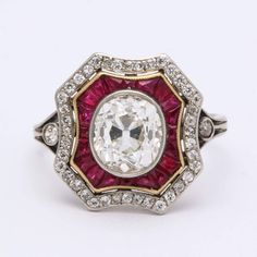One more ruby feature before I diverge from RED, in the form of a c.1930 Art Deco ring from À la vieille Russie... a cluster ring in an 8-sided shield shape with a diamond cluster, a centre diamond and the rubies cut calibre and delineated in yellow gold.