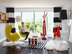 HGTV Star David Bromstad Is Selling His Condo And We Get To Look Inside HGTV star and interior designer David Bromstad is selling his home a 2 bedroom 3 bathroom condo in Bal Harbour nbsp hellip Hgtv Magazine, Diy Living Room Paint, Living Rooms, Egg Shaped Chair, 80s Interior Design, Condo Interior, Interior Decorating, Decorating Ideas, David Bromstad
