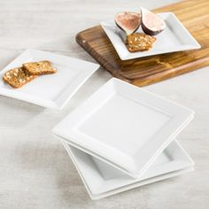 The set of 6 Aurora Appetizer Plates are the perfect size for a wine and cheese event.  The 13.5 cm square porcelain plates sit easily in the hand and hold the perfect amount of food.  Dishwasher safe.