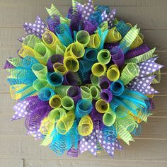 This whimsical spring deco mesh wreath will stand out on any front door! High quality mesh is used that is resistant to outdoor elements. A unique