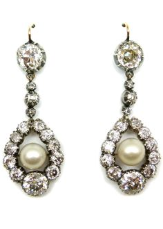 Pair of Victorian diamond and pearl pendant earrings, c.1880, each with a graduated drop shaped diamond cluster frame centred by a round white pearl, from collet diamond tops with three smaller diamonds in between, cut-down collet set in silver and gold