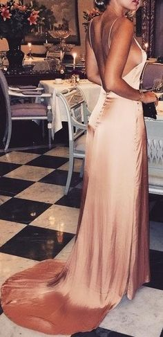 She looks stunning in this maxi silk dress. Somebody takes me to a fancy dinner so I can wear this please