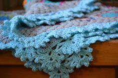 When I posted my crochet throw a while back, I promised to post the edging pattern so here it is. The laciness adds a lovely dimension to the throw, and I'm definitely planning on using it on a sh...