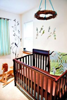 Bird Theme Baby Nursery with many homemade items made with love by mom, dad and many other special friends and family members. I love a bird nursery theme and this Birds and Branches themed room decorated for a baby boy is my current favorite.  What I find most appealing about