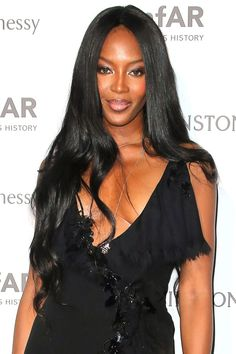 As her decades-long career has continued on, Campbell's signature black locks have grown longer and longer.   - HarpersBAZAAR.com