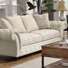 With its classic Chesterfield silhouette and script-print upholstery, this wood-framed sofa is positively posh. Let it lend a touch of edge to a delightfully...