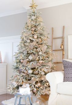 it definitely makes the tree appear fuller a snowy flocked christmas tree decorated in silver and rose gold adds a big dose of holiday cheer - Pictures Of Christmas Trees Decorated Beautifully