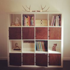 IKEA hack: 4 white deep shelved bookcases and combine them together by staples then display in living room area, bedroom or even a formal dining room area. Love it!