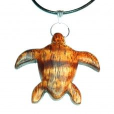 For our partnership with Sea Turtle Conservancy, we have created a special line of handmade turtle-themed items. For every sale of an item from the Sea Turtle collection, 20% will be donated directly to STC.  This sea turtle pendant is handmade from Curly Koa. Curly Koa grows in Hawaii and is valued for its gorgeous curly grain and figure.