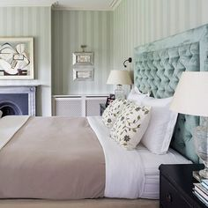 A beautiful and relaxing bedroom by Stephanie Dunning of @dunning_designs. The bed, with its comfortable oversized headboard, is set high to allow a clear view through the window, overlooking Hampshire's Test Valley. @farrowandball's Plain Stripe wallpaper brings formality to the room while dedicate embroidery and velvet textures add a tactile quality. #bedroom #interior #homes photograph @markboltonphoto