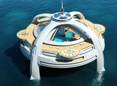 The Utopia can be many things, from a shiplike hotel to a reasearch station for studying ocean animals. This large floating world rests on four legs that extend and float about 50 ft below the surface. When it's not a home for marine biologists, it can accommodate tourists. Take a helicopter, boat, or minsub. Lounge in luxurious guest suites, pools, and restaurants. It even has a movie theatre but the best part is the top deck, where a 360 degree observatory is high above the waters surface.