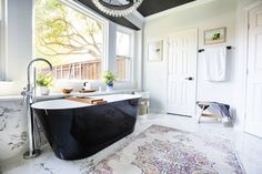 Black freestanding Tub in a black white and gray bathroom.  Black ceiling in the bathroom.  Marble bathroom floors black accents.  Black and white Bathroom with natural accents. Marble Bathroom Floor, Bathroom Black, Grey Bathrooms, Bathroom Flooring, Master Bathroom, Freestanding Tub, Black Ceiling, Bathroom Goals, Black Accents