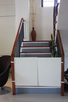 DIY baby gate (wooden dowels on top & bottom, velcro sides for railings)