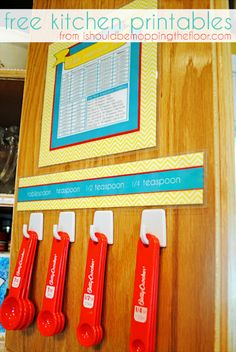 Free Kitchen Conversion chart printable: LOVE the measuring spoons on the door!