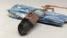 Smokey Quartz - Pendant - Smoky Quartz - Copper Electroformed - Raw Crystal Necklace - Rustic - Boho - Hippie - Garnet Jewelry - Unique Gift  This is a nice Smoky Quartz crystal that I paired with a Garnet teardrop. I created this pendant using the long process of copper electroforming. It takes between 12-24 hours to make. It hangs from a long, antique copper colored chain. I gave the copper a nice patina which gives it that rustic, antique look.  Pendant measures almost 2 5/8 inches ta...