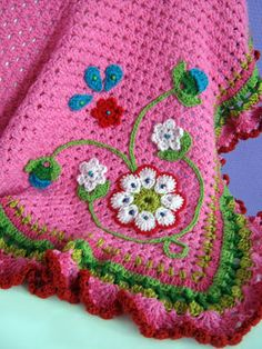 Amazing folky flowery crochet - good alternative to detailed rows or squares.