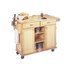 This Natural Wood Finish Kitchen Island Cart with Locking Casters has a clean style and natural finish that provides culinary function to any kitchen. It features a solid wood top, spice and condiment