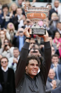 Spain's Rafael Nadal Holds 7 titles in Roland Garros. The 2012 French Open Champion and King of Clay. VAMOS!!