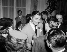 That's my (then 17 year old) grandfather behind Clark Gable at the premiere of Gone With The Wind. (January 17, 1940) [400 dpi]