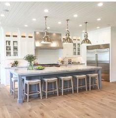 Love the floors, white cabinets and alternate color on the island (maybe gray, brown, black?) like that the bar stools fully slide under the counter