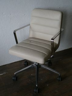 Bid on this wonderful Bernhardt conference chair donated by Design Products Inc.! It features white leather seat and back with horizontal seaming and a 5-star chrome base and loop arms. Retail Value: $1,800.00