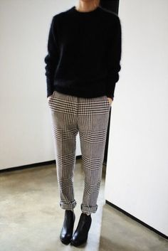 Picture Of checked trousers, a black cashmere sweater and black booties for the office