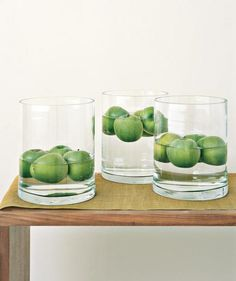 Float bright Granny Smiths in large, clear-glass vases (filled to different levels) for a whimsical still life.