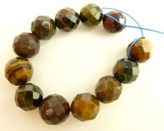 Natural Golden and Red Mix of tiger eye gemstone round faceted beads. Grade B. Set of 12. Size is 8mm. Mix with gold filled beads for a rich and warm look. Or try using these with citrine gemstone bea