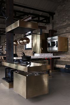 brushed steel, copper, exposed brick and beams, marble countertop