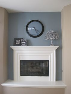 One wall of a design remodel in Canyon Lake, California. Beautiful paint colors and modern accessories accent the  fireplace wall.