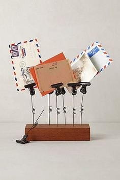 A photo & letter holder can organize even the most cluttered of desks and countertops