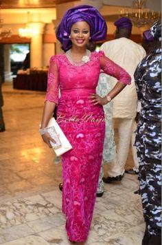 Nigerian wedding guest in Pink Iro and Buba Lace and Purple Gele. Aso-ebi styles.