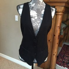 Black Guess vest size M Black Guess vest. The back is darling with cute silver and black embezzlements. It is in great condition, worn only a few times. Size M. Guess Jackets & Coats Vests