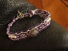 SOLD:  Purple is for passion in this purple and white hemp jewelry!  For more bracelets, chokers and anklets, head on over to:  www.trinitybydesign.etsy.com  Thanks for your support of Trinity Jewelry by Design