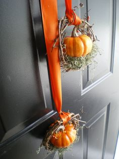 autumn mini pumpkins w/ ribbon/ I like this concept but instead of the little wreath just wrap the ribbon around the pumpkin like a gift and hang it by a long strand! I'd use copper ribbon!