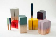 I've had wood blocks on the brain lately as I've been designing jewelry displays for retail and sales purposes for my business. The moment I laid eyes on the gorgeous ombre painted wood pieces by Judith Seng, they were permanently burned into my brain. Now, I'm not only trying to figure out how to incorporate similar ideas into my jewelry displays, but I want them, in all sizes, around my home!