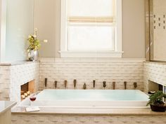 Infinity tub, fireplace, and woven relief subway tile Can I live here?