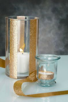 Gold glitter ribbon as a cheap and super simple way to add sparkle to plain cylinder vases or even to tea lights. We just used double-sided tape to adhere the ribbon to glass and metal surfaces. #DIY by jacklyn