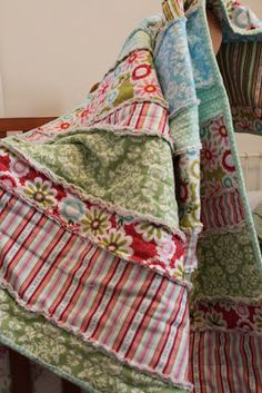 Darling rag quilt made with strips.