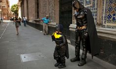 I'm Batman - No, I'm Batman! Mexico City, Santiago Gomez, dressed in a Batman costume, poses for a photograph with a Batman street performer. Gomez's parents Rosio and Pepe brought him from Toluca as a gift for his sixth birthday, which is tomorrow. Photograph: Ivan Pierre Aguirre/AP